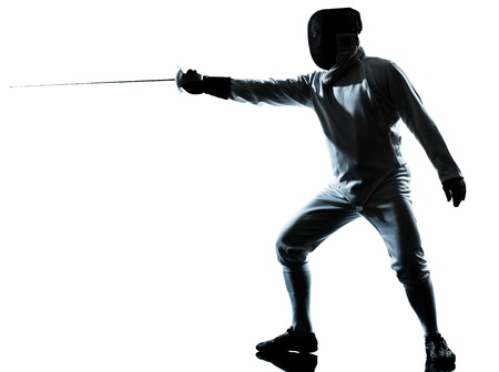 fencing foil: one man fencing silhouette in studio isolated on white background