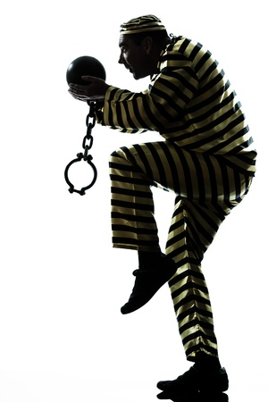 one caucasian man prisoner criminal escaping with chain ball in studio isolated on white background Stock Photo - 15483001