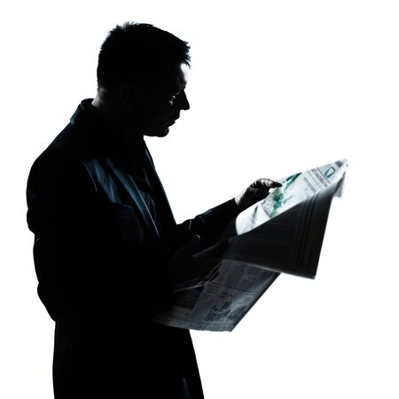 one caucasian man portrait silhouette reading newspaper in studio isolated on white background photo