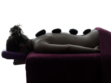 one woman lying on a massage table in silhouette studio on white background Stock Photo - 15441920