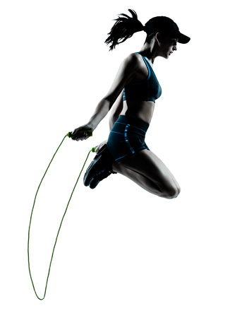 jogger: one caucasian woman runner jogger jumping rope in silhouette studio isolated on white background