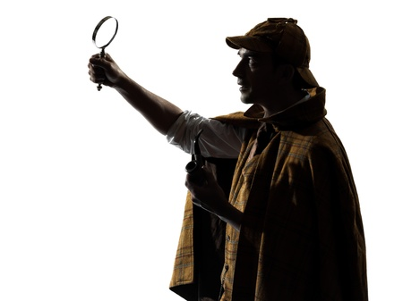 mystery man: sherlock holmes silhouette in studio on white background