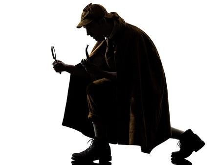 suspicion: sherlock holmes silhouette in studio on white background