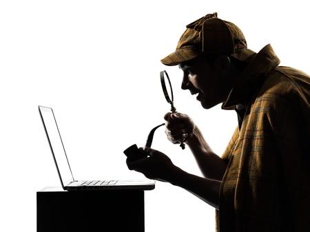 investigacion: sherlock holmes silueta en estudio en el fondo blanco Foto de archivo