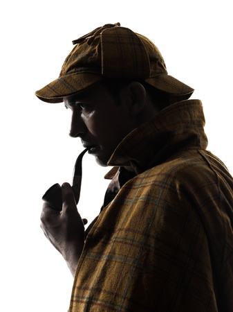 inspector: sherlock holmes silhouette in studio on white background