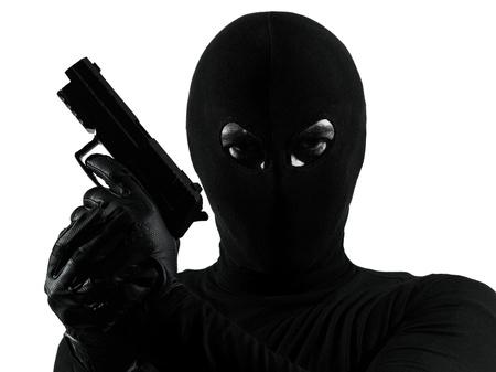 thief criminal terrorist holding gun portrait in silhouette studio isolated on white background Stock Photo - 15441922