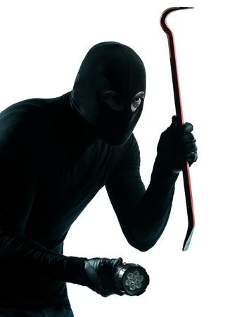 mistery: thief criminal burglar portrait masked  in silhouette studio isolated on white background Stock Photo