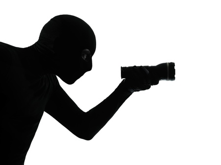 looting: thief criminal burglar portrait silhouette masked in silhouette studio isolated on white background