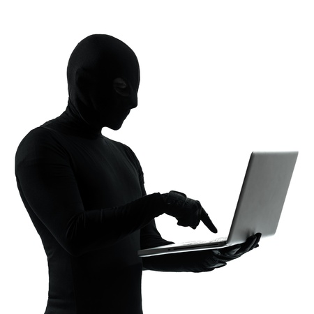 hacker: thief criminal computer hacker  in silhouette studio isolated on white background