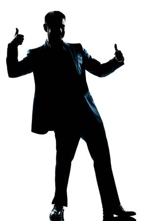 one caucasian man double thumb up full length silhouette in studio isolated white background photo