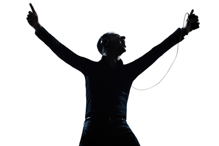 singer silhouette: one caucasian man happy listening to music portrait silhouette in studio isolated white background Stock Photo