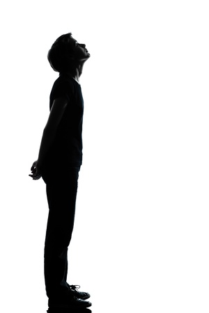 one caucasian young teenager silhouette boy or girl full length in studio cut out isolated on white background photo