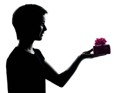 one caucasian young teenager silhouette boy or girl offering present gift  portrait in studio cut out isolated on white background photo