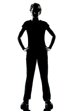 teen silhouette: one caucasian young teenager silhouette boy or girl standing hands on hips full length in studio cut out isolated on white background