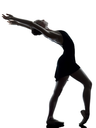 one caucasian young woman ballerina ballet dancer stretching warming up in silhouette studio on white background photo