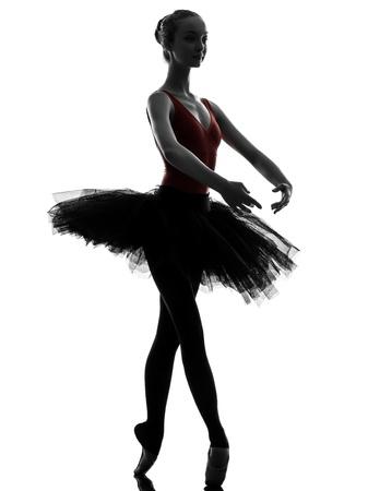 silueta bailarina: una mujer cauc�sica joven bailarina de ballet bailarina bailando con tut� en el estudio de la silueta en el fondo blanco Foto de archivo