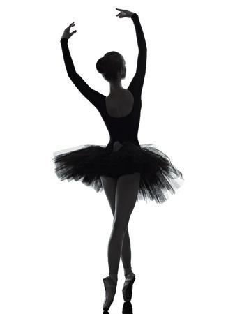 bailarin: una mujer cauc�sica joven bailarina de ballet bailarina bailando con tut� en el estudio de la silueta en el fondo blanco Foto de archivo