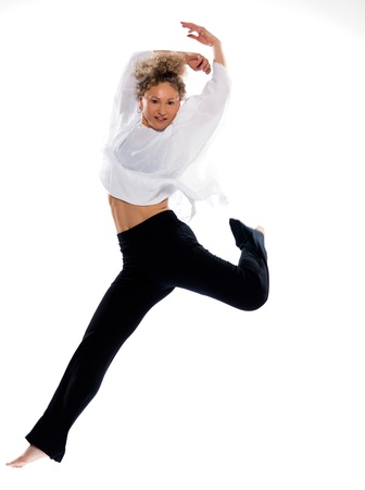 practicing: beautiful mature woman dancing modern ballet on isolated white background