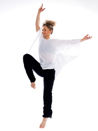 beautiful mature woman dancing modern ballet on isolated white background photo
