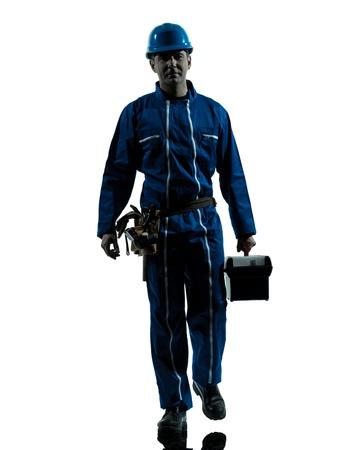 dělník: jeden kavkazského opravář pracovník silueta v ateliéru na bílém pozadí Reklamní fotografie