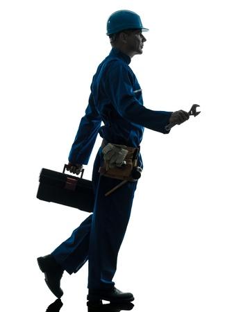 class maintenance: one caucasian repairman worker silhouette in studio on white background