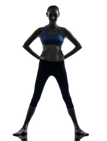 one caucasian woman exercising fitness standing in silhouette studio isolated on white background photo