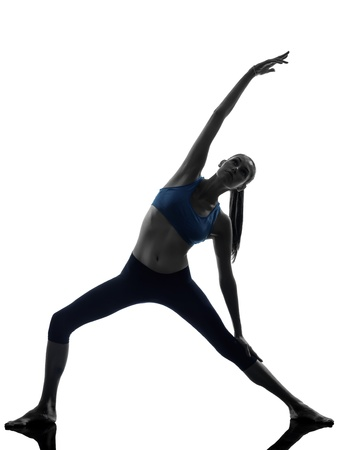 lunges: one caucasian woman exercising stretching triangle pose yoga in silhouette studio isolated on white background