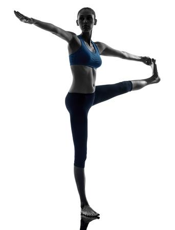 hasta: one caucasian woman exercising yoga Hasta Padangusthasana in silhouette studio isolated on white background Stock Photo