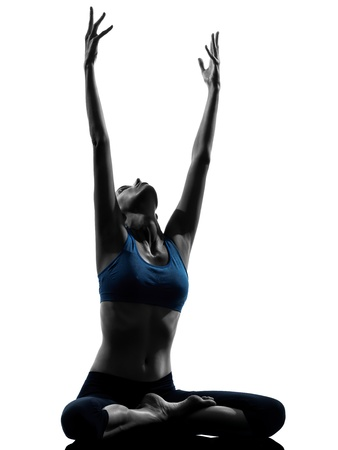 yoga silhouette: one caucasian woman exercising yoga meditating sitting stretching in silhouette studio isolated on white background Stock Photo