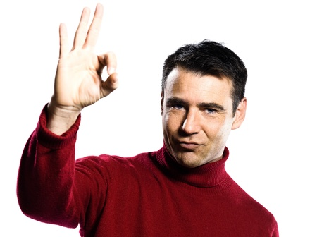 handsign: caucasian man ok hand sign gesture studio portrait on isolated white backgound