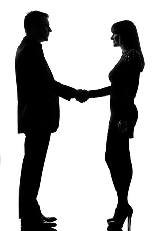 seduction: one caucasian couple man and woman handshake in studio silhouette isolated on white background