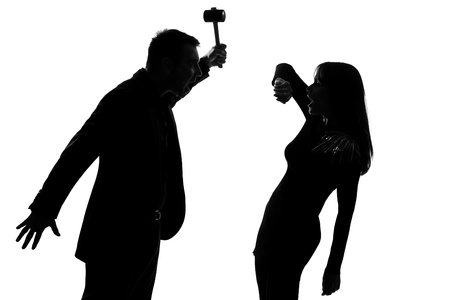 one caucasian couple man and woman expressing domestic violence in studio silhouette isolated on white background photo