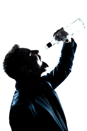 one caucasian man portrait silhouette drunk puring empty alcohol botlle in studio isolated white background Stock Photo - 15641646