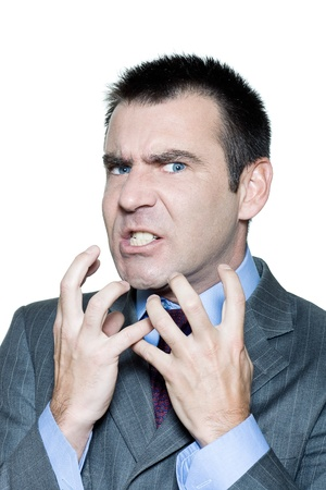 aggressive people: Closeup portrait of an expressive angry mature man in studio on isolated white background
