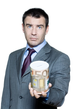 Portrait of businessman holding money box begging for money in studio on isolated white background photo