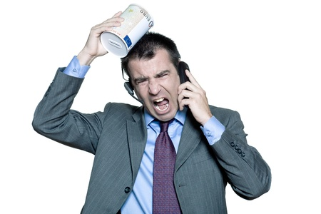 Portrait of angry businessman shouting on phone in studio on isolated white background photo