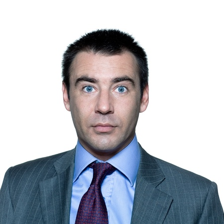 eyes wide: Closeup portrait of a shocked handsome mature man with wide open eyes in studio on isolated white background