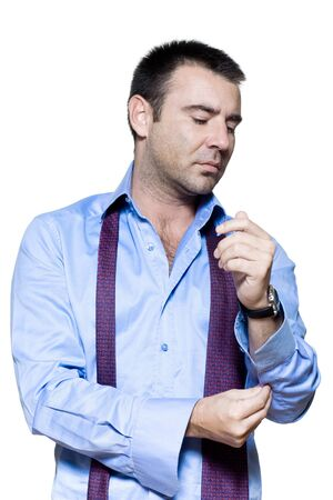 adjusting: Portrait of a mature man getting dressed in studio isolated on white background Stock Photo