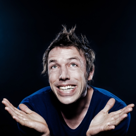 studio portrait on black background of a funny expressive caucasian man puckering ecstatic photo