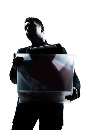 one caucasian business man portrait silhouette carrying heavy box in studio isolated white background photo