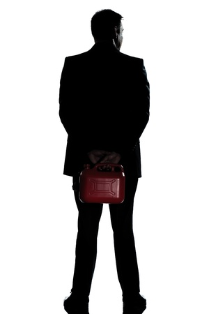 one caucasian man out of gas holding can  full length silhouette in studio isolated white background photo