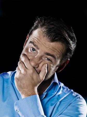 perplex: caucasian man unshaven despair toothache portrait isolated studio on black background