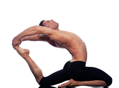 Man yoga Eka Pada Rajakapotasana pose One-Legged King Pigeon stretch gymnastic acrobatics  studio on white background photo