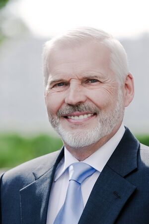 caucasian senior businessman portrait smiling cheerful Stock Photo - 15629509