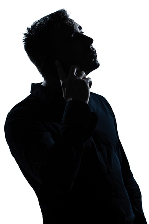 one caucasian man caring serious portrait silhouette in studio isolated white background photo