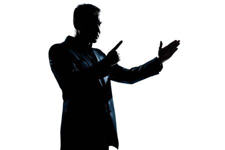 one caucasian man angry menacing portrait silhouette in studio isolated white background photo