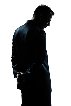 one caucasian man portrait silhouette backside sad despair lonely in studio isolated white background Stock Photo - 15641597