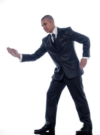 caucasian man businessman walking  portrait isolated studio on white background photo