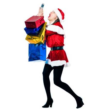 one woman dressed as santa claus carrying despair on the telephone christmas bags  on studio isolated white background photo