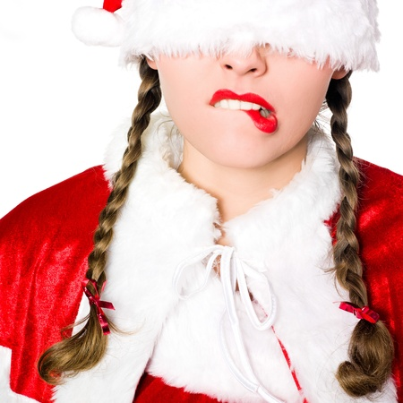 puckering: close up portrait of one woman dressed as santa claus christmas hat blinfold puckering on studio isolated white background
